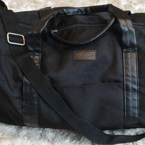 Black Calvin Klein duffle bag